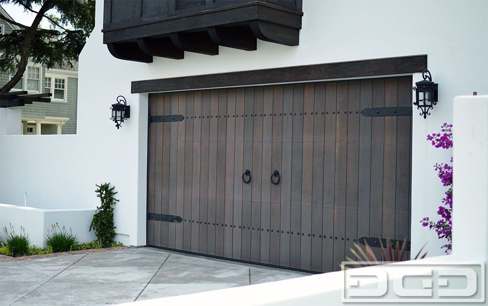 Dynamic Garage Door   Santa Ana, CA, United States. Spanish Style Wood Garage  Door Handmade In Solid Vertical Grain Doug Fir. Decorated With Spanish  Style ...