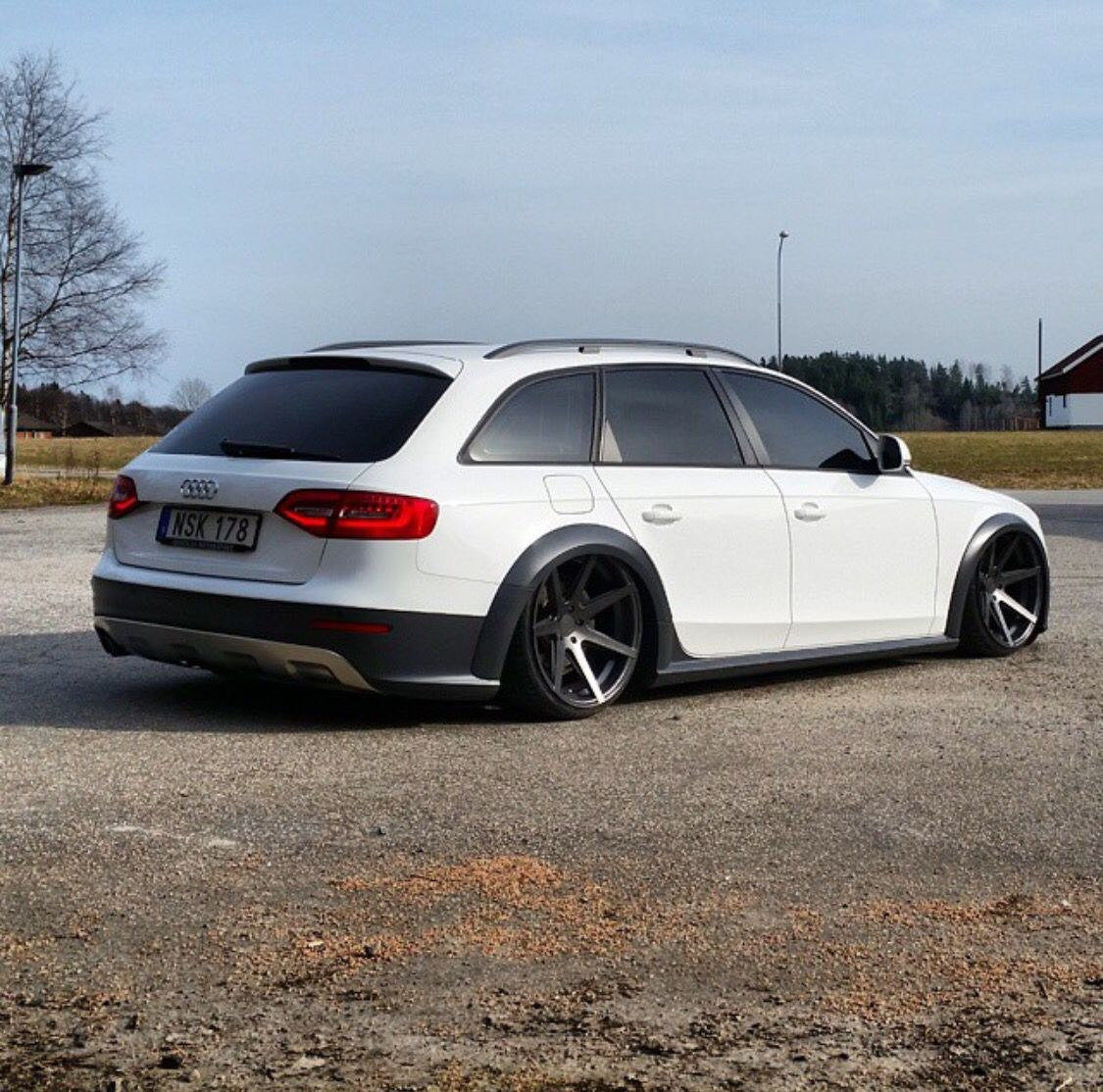 White Audi Allroad With Black Wheels