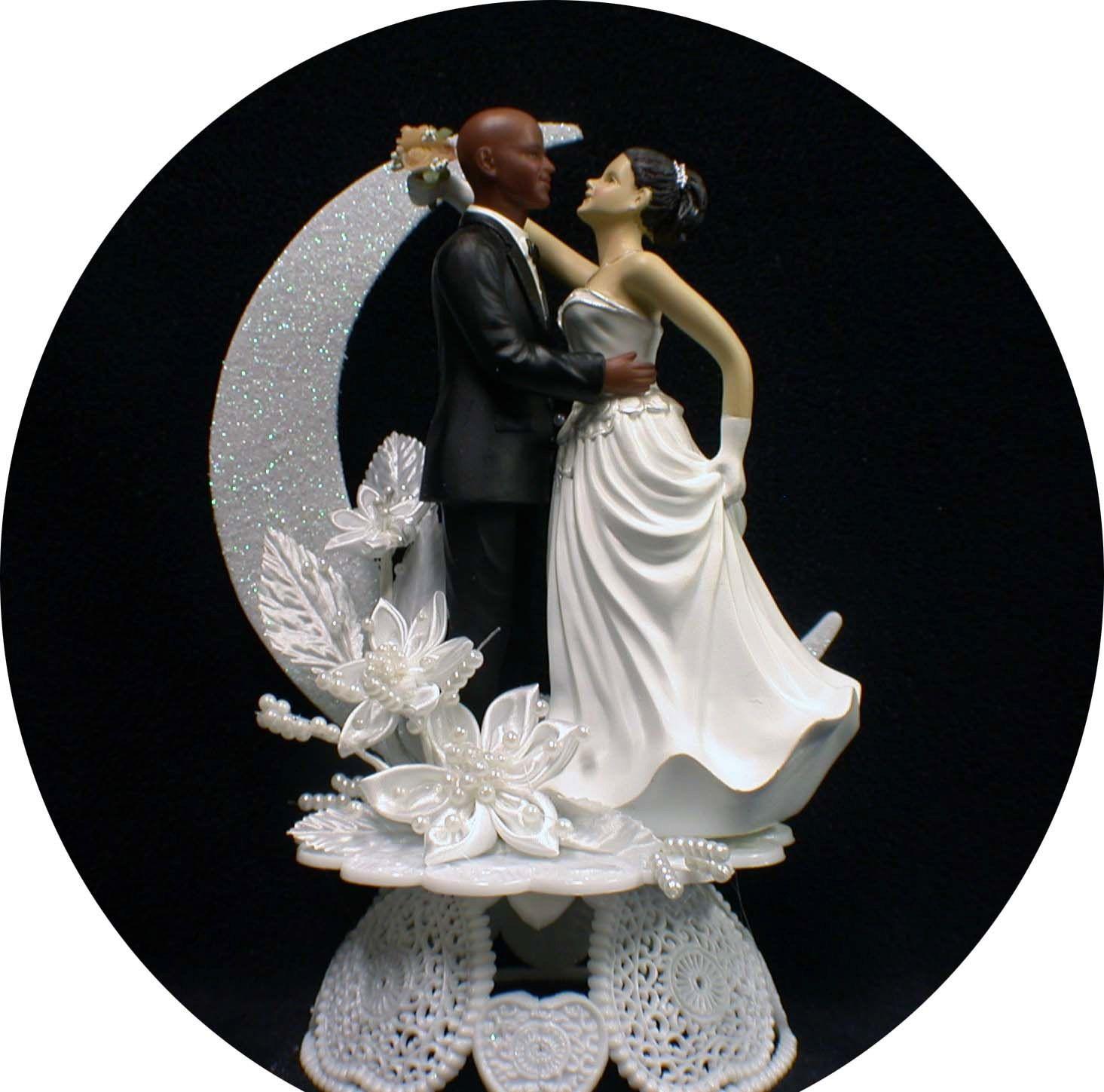 bald african american groom white bride brown hair wedding cake