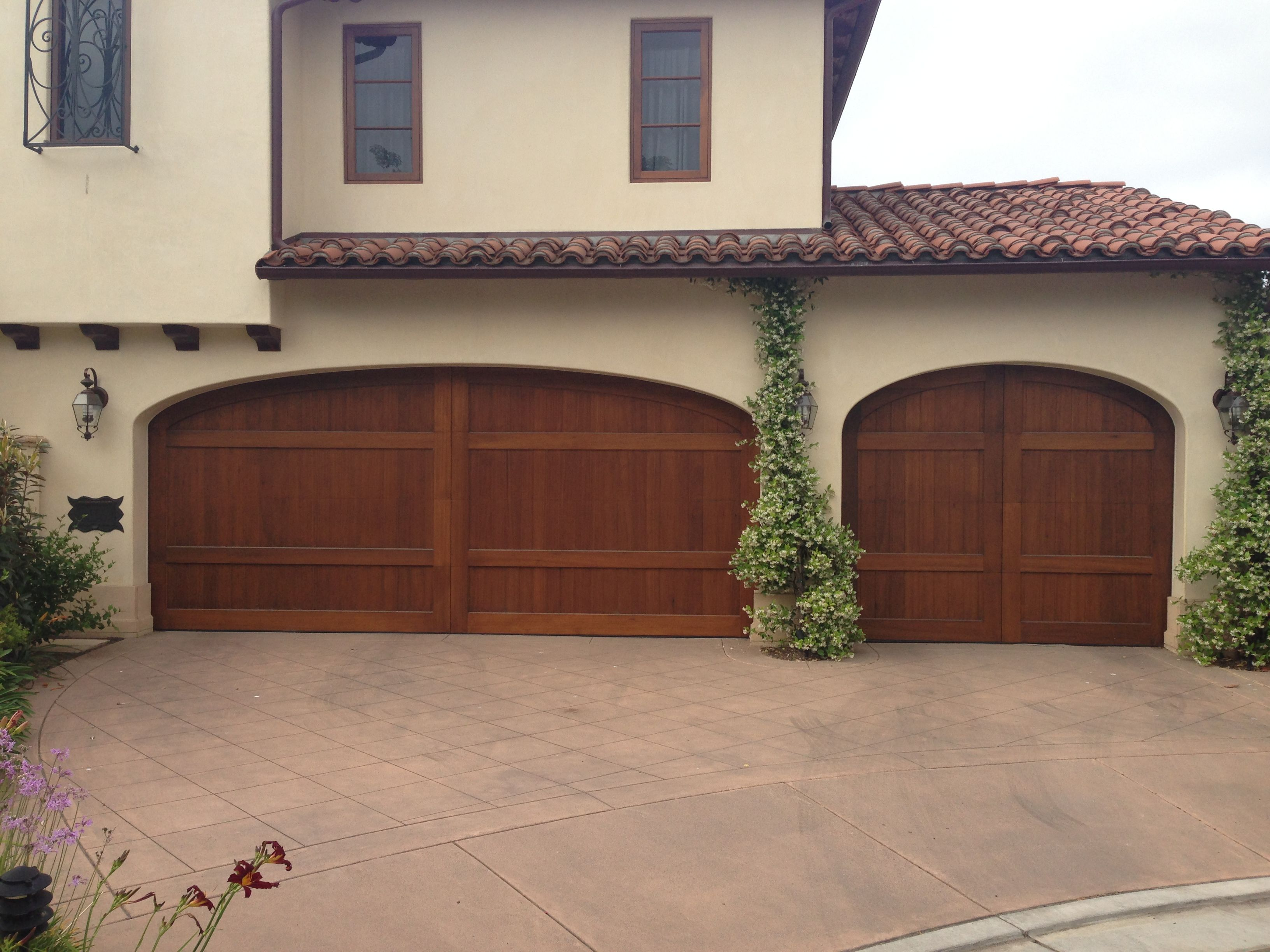 Custom wood stain grade sectional garage doors installed in san custom wood stain grade sectional garage doors installed in san diego beautiful natural wood rubansaba