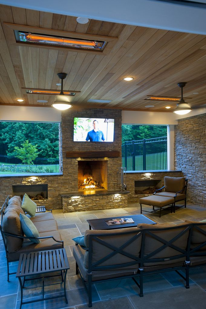 Features Include:   Recessed Hot Tub   Flagstone Patio And A Curved  Retaining Wall