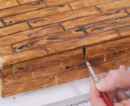 Learn how to make a fondant cake look just like real wood. Follow simple step-by-step photos to create an oak woodgrain effect.