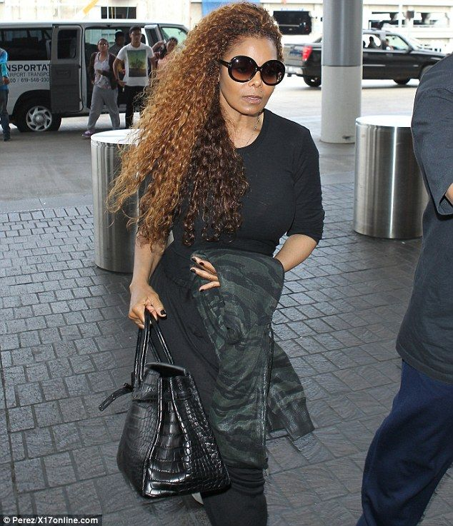 Janet Jackson Rocks Multi Coloured Mane While Jetting Out Of Lax