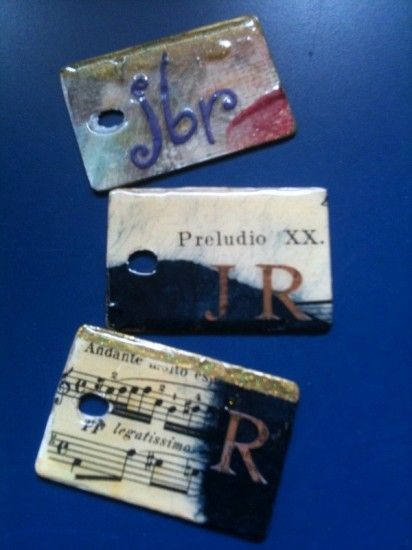 Recycled Laminate Chip Samples, Music/Pages/Maps are decoupaged into Zipper Pulls and Luggage Tags tutorial