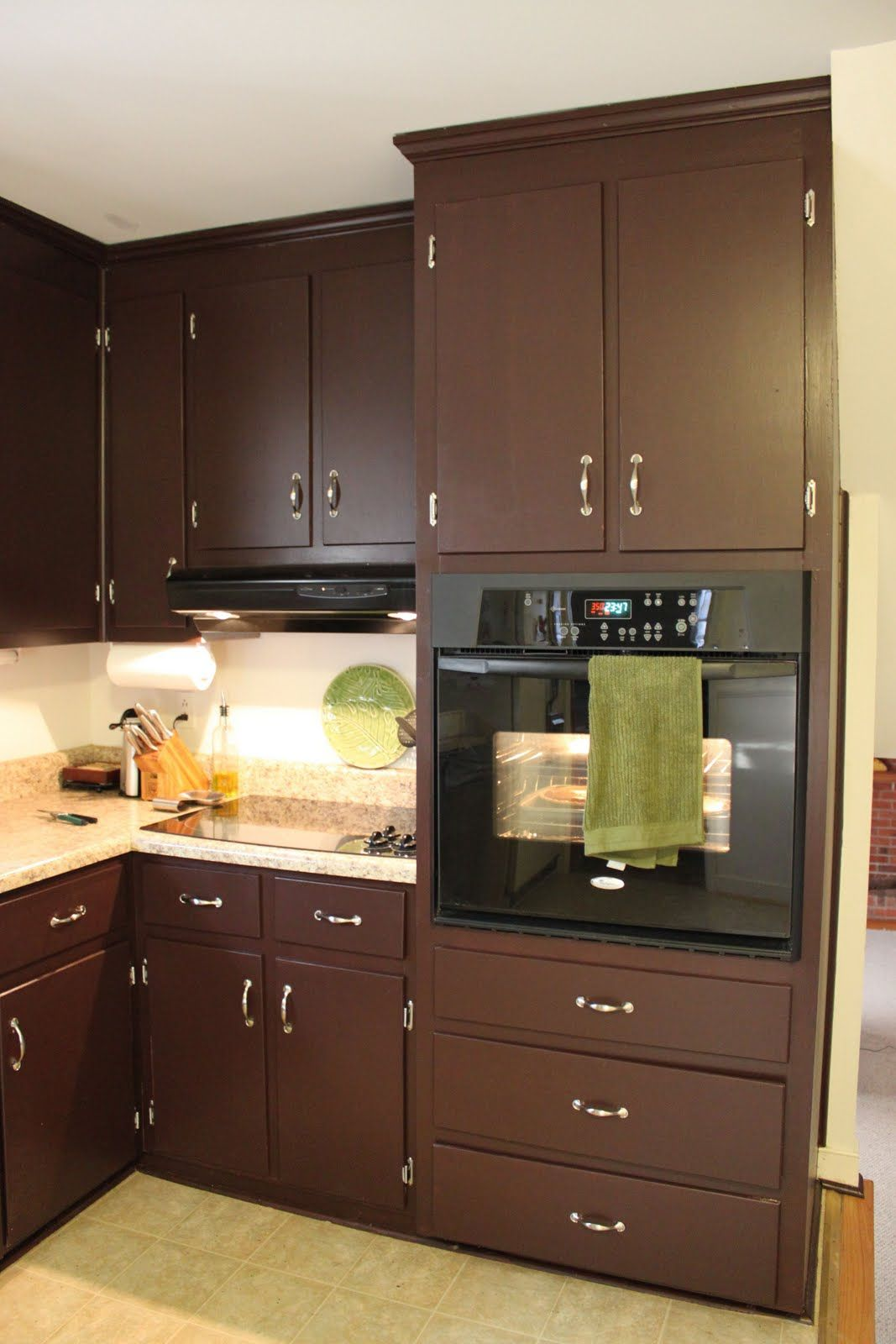 Brown painted kitchen cabinets silver hardware looks for Painted cabinets in kitchen