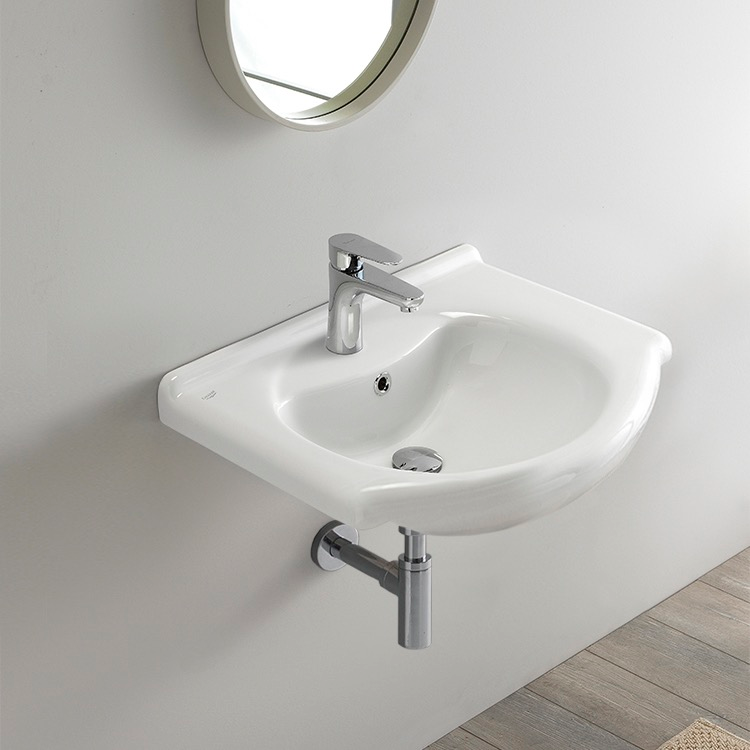 Photo of Rectangular white ceramic wall mount or drop-in sink