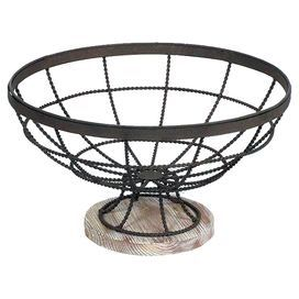 """Openwork metal bowl with a wood-grained base.   Product: Decorative bowlConstruction Material: MDF and metalColor: DistressedDimensions: 7.25"""" H x 12.75"""" Diameter"""