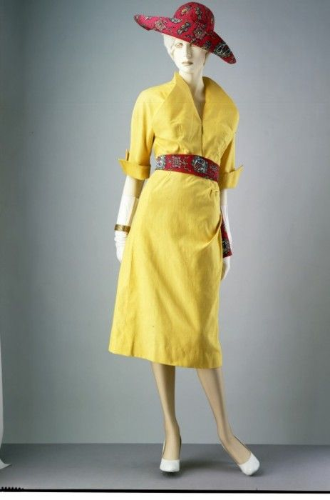 This ultra-chic 1949 summer ensemble by Jacques Fath hints at the new, slim lines of the early 1950s.