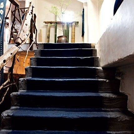 This Simple Runner Covering Rustic Concrete Stairs, Paired