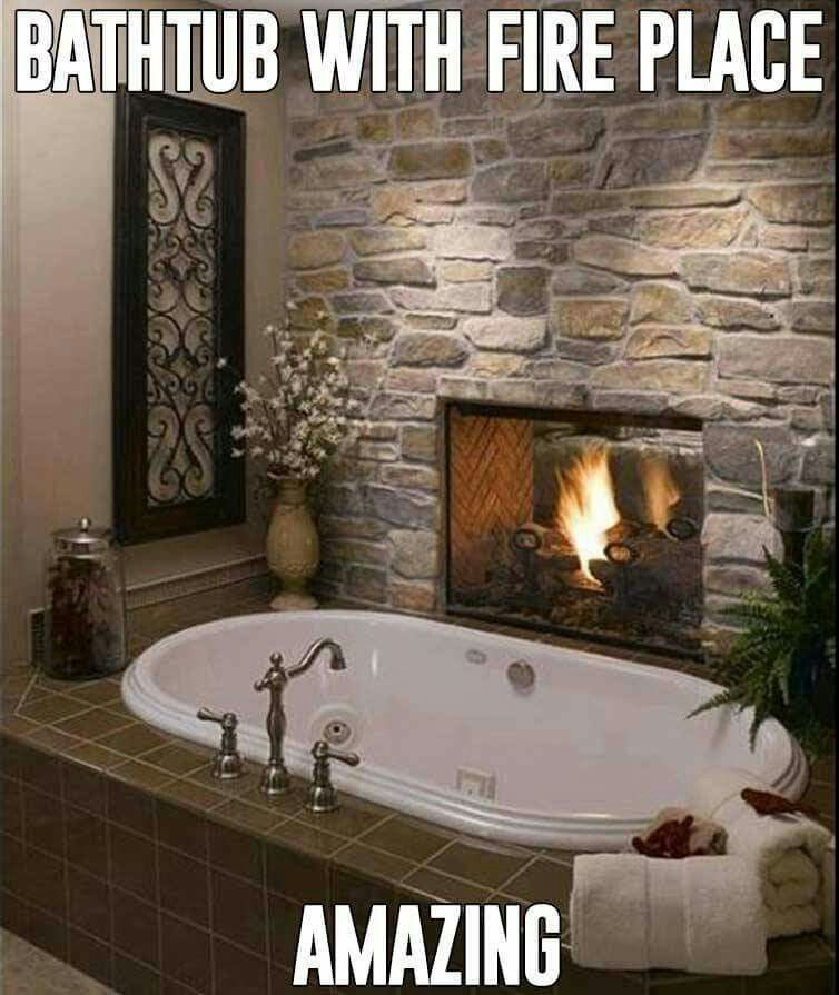 Bathtub with a fire place !!! Whole new meaning to relaxed