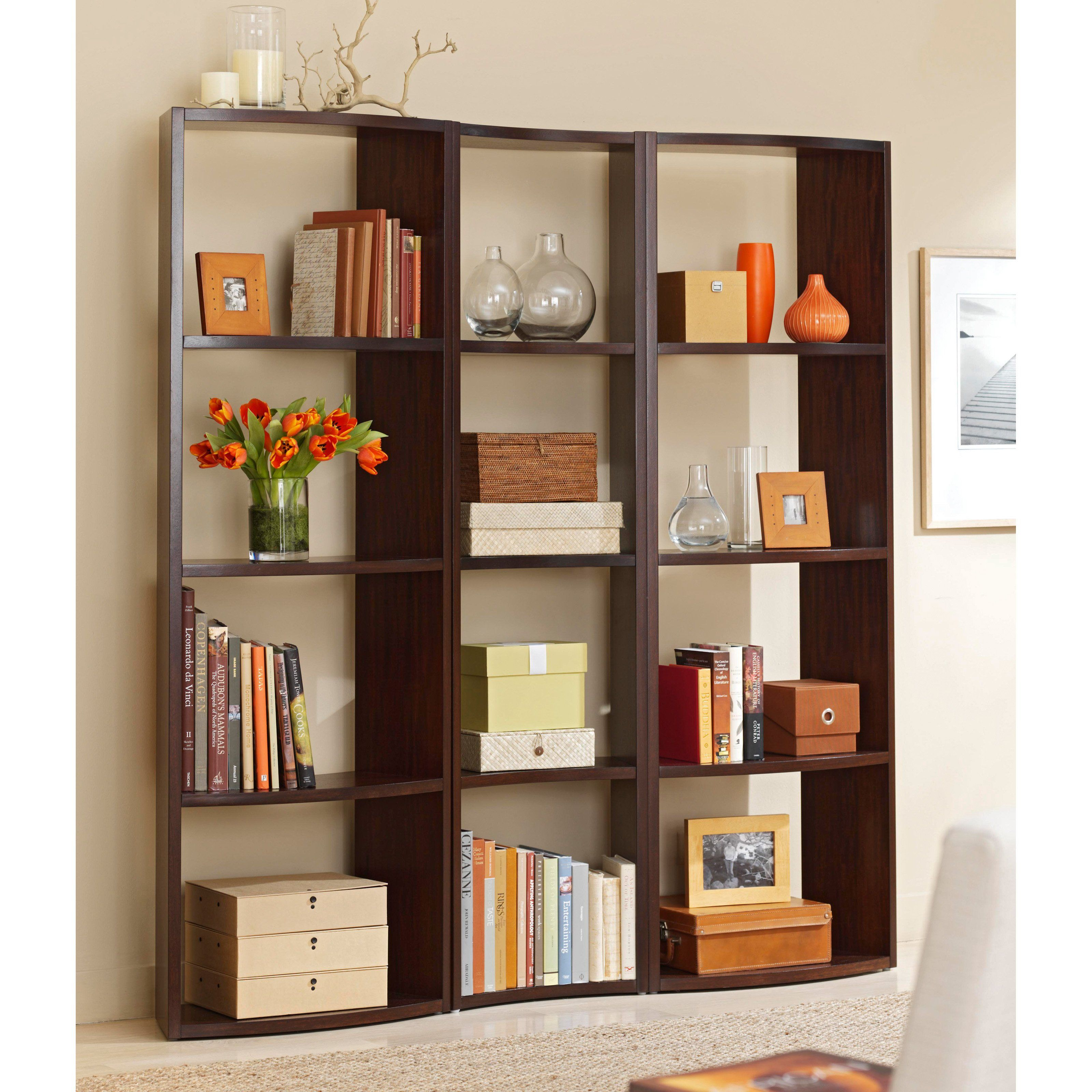 One Single Bookcase Against A Wall Provides A Tall Slim Space For  Displaying Books Framed Photos