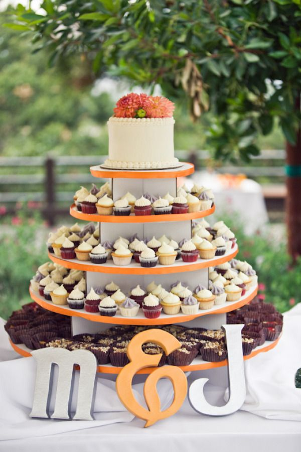 Tiered cupcake display -- lots of other cute ideas in this orange wedding.
