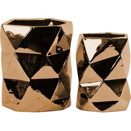 Lend modern appeal to your coffee table or sideboard with these ceramic candleholders, showcasing a polished chrome copper finish and hexagonal designs....