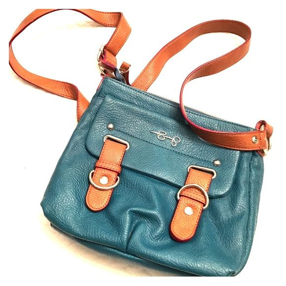 Jessica Simpson blue and tan cross body purse Small blue cross body with pockets on the front of the purse and several on the inside. Great little purse to fit your wallet and a few other necessities in. Has been loved, so there's some wearing on the back side of the purse where the bag meets your leg. Jessica Simpson Bags Crossbody Bags