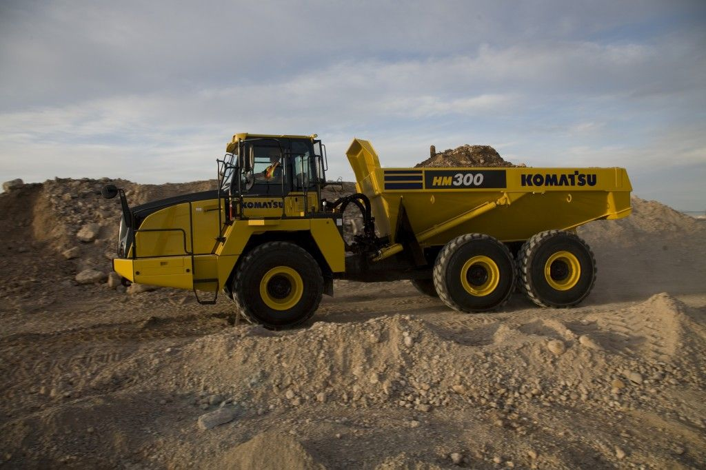 The New Komatsu Hm300 3 Dump Truck An Enhanced Performance On Any Rough Terrain Find More Models Of Komatsu Dumper Dump Trucks For Sale Dump Trucks Komatsu