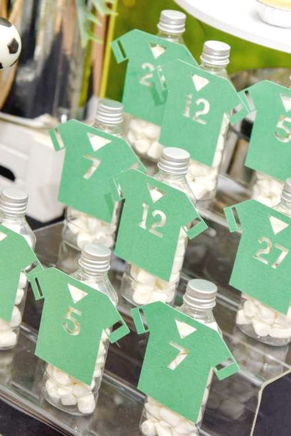 Check out this cool soccer-themed 1st birthday party! The soccer shirt party favors are…