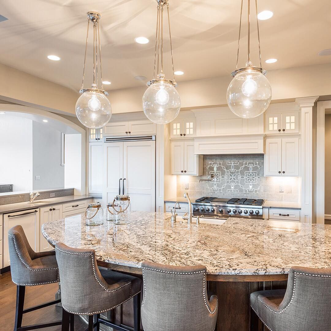 This Curved Edge Island Features A Granite Countertop Which