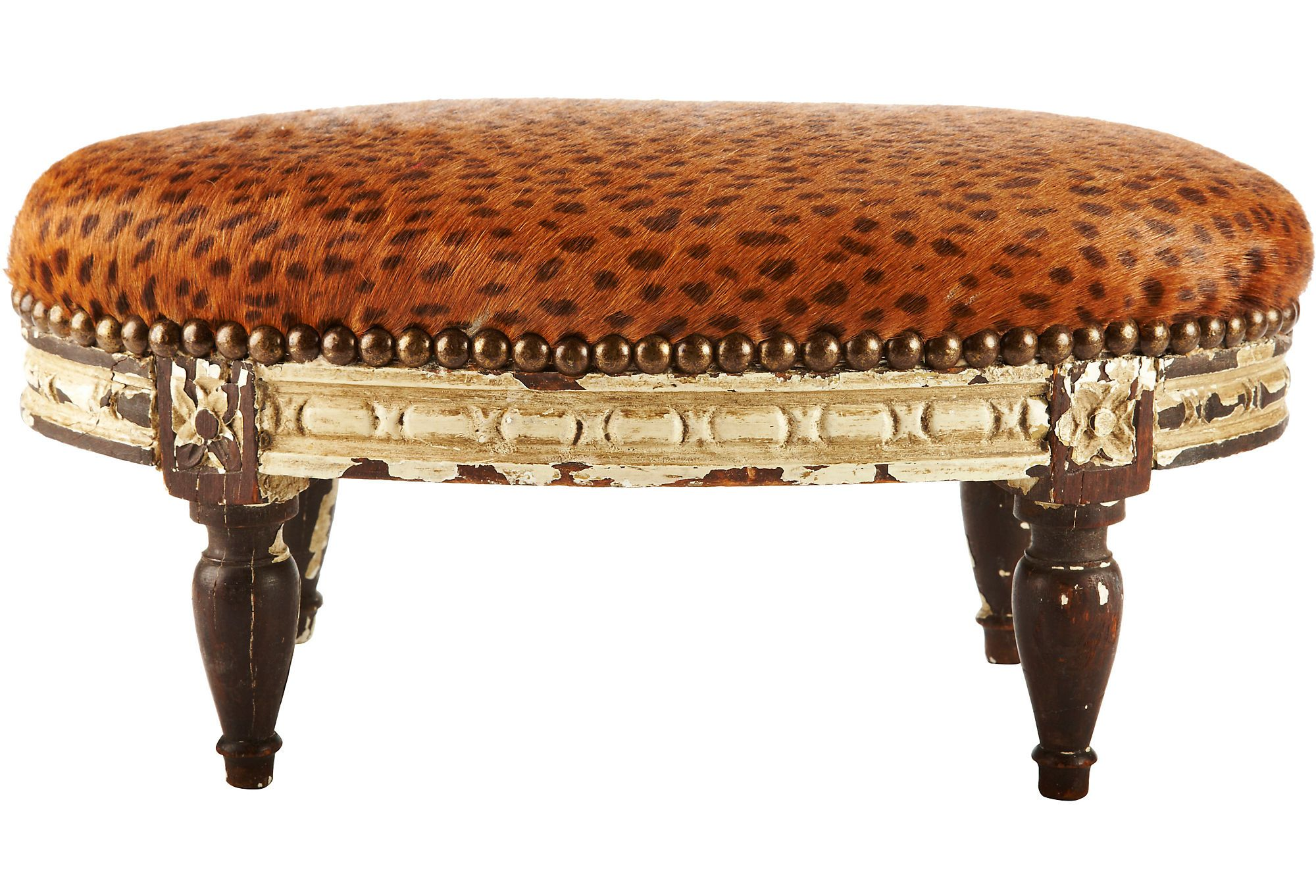 Antique French footstool with stenciled leopard cowhide.