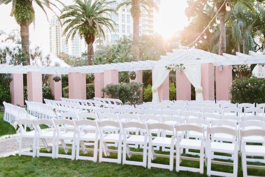 Luxurious downtown St. Pete ballroom wedding at hotel venue the Vinoy Renaissance. Destination wedding with St. Petersburg wedding planner NK Productions  w arch and decor Flowers by Fudgie