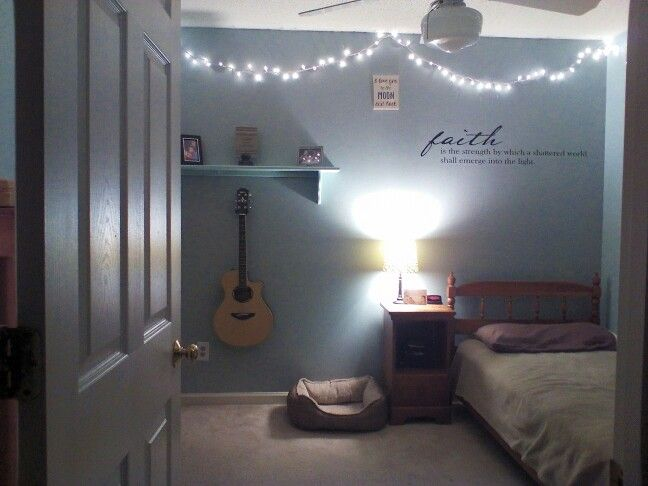 Inexpensive room idea! Christmas lights, wall decal, decorative lamp, as stand for guitar, (if you already own one, and neutral colors mixes with 1-2 brighter colors! (My room is the one show!)( Guitar stand form Guitar Center for $10, Lights were $8 from Walmart, Lamp Shade was from Walmart, $10, and wall decal was from Michael's for $20.