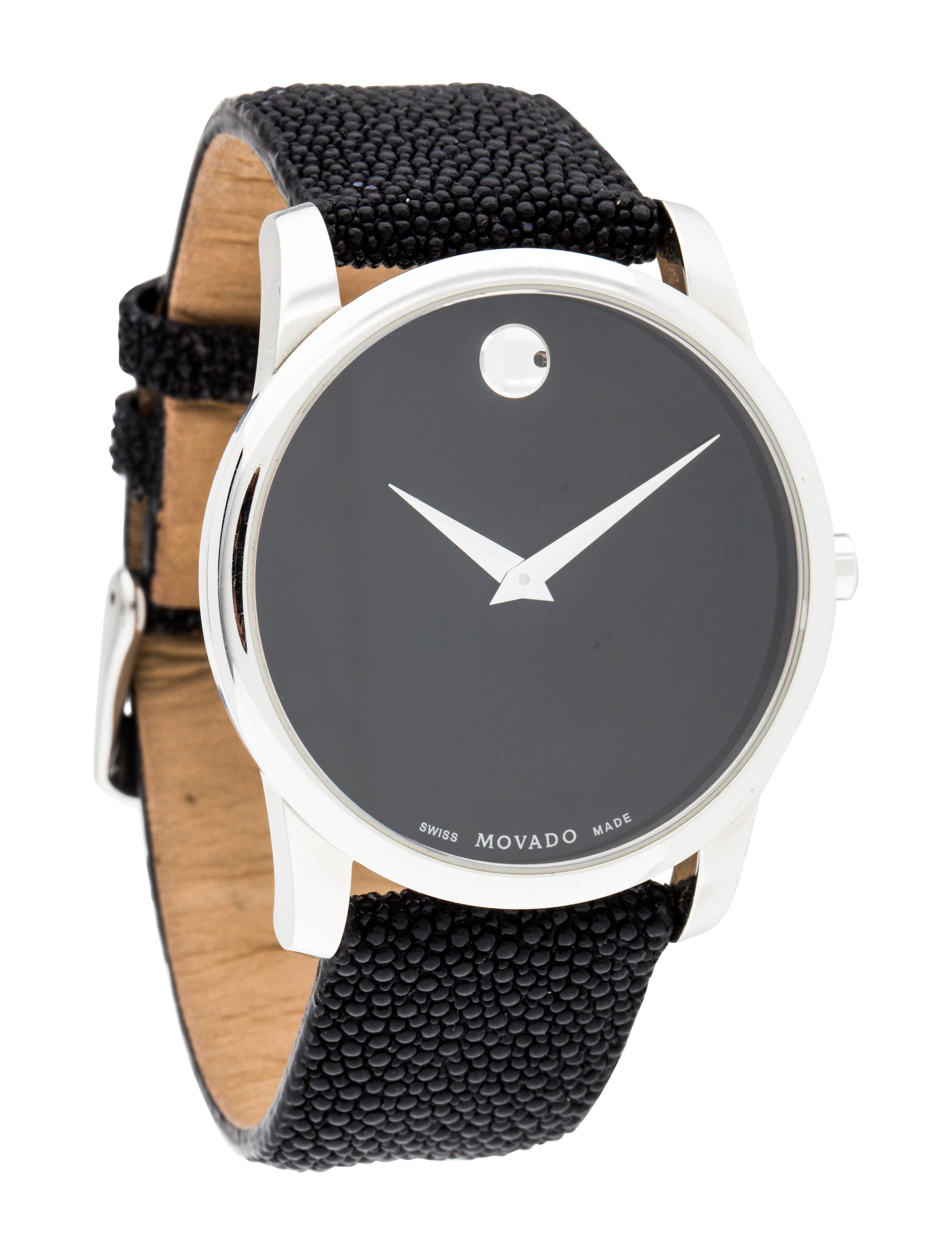 ba3130212 Stainless steel 40mm Movado Museum watch featuring a quartz movement,  smooth bezel, matte black dial and black stingray strap with tang buckle.  Includes d