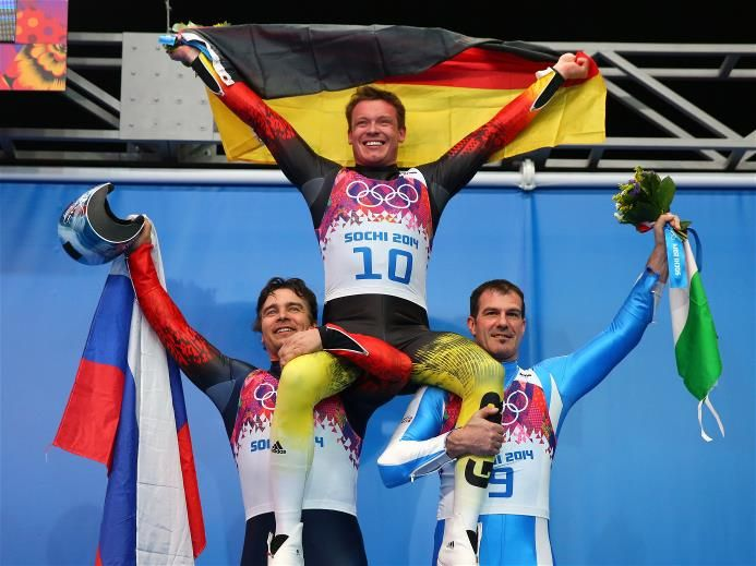 Silver medalist Albert Demchenko of Russia, gold medalist Felix Loch of Germany and bronze medalist Armin Zoeggeler of Italy on the podium