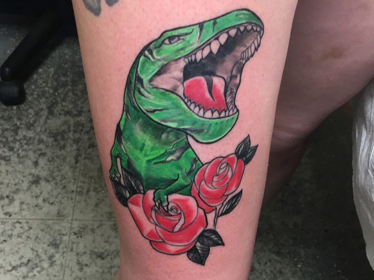 TRex Tattoo With Roses Breyner Alarcon Tattoo Shop in