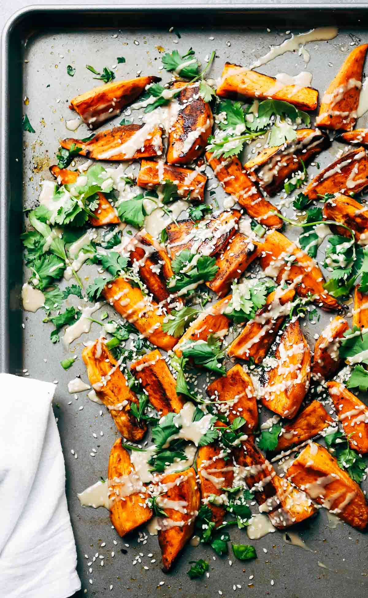 30-Minute Sesame Roasted Sweet Potatoes by pinchofyum: A quick and easy vegetarian side that is beautiful and full of yummy sesame flavor. #Sweet_Potatoes #Sesame #Cilantro #Easy