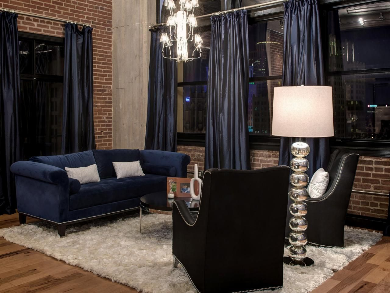 Navy blue bedroom curtains - Navy Blue Curtains And Sofa Combine With Black Leather Chairs To Create An Elegant Feel In