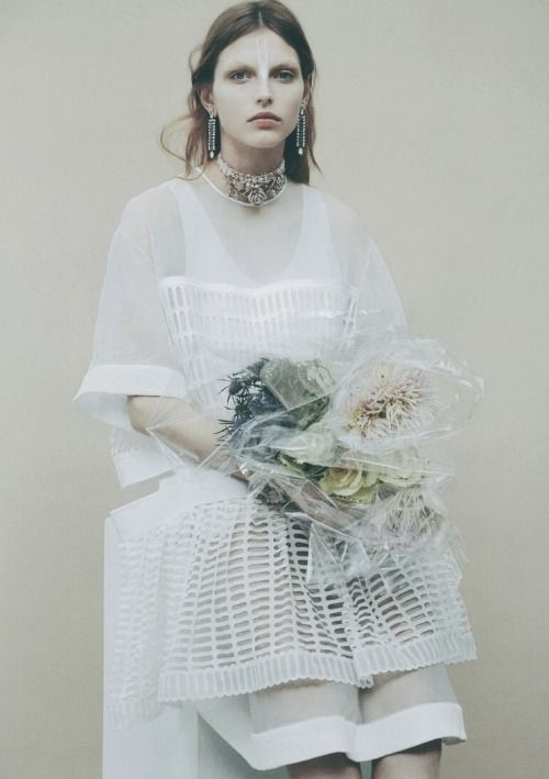 """Woman in White,"" photographed by Charlotta Manaigo for Mixte Magazine S/S 2013"