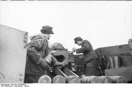 "The crew of aGeschützwagen III/IV""Hummel"" self-propelled artillery gun load 15 cm shells into their vehicle, January/February 1944."