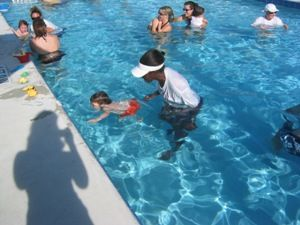 Kids Having Fun In The Water And Learning A Life Long Skill Babyotter Org Swim Lessons Lessons For Kids Swim School