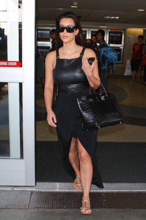 Kim Kardashian wearing Giuseppe Zanotti Metal T-Strap Sandal Hermes 35cm Birkin Bag in Black Croc Celine Matrix Top Heavy sunglasses. Kim Kardashian LAX airport September 25 2012.