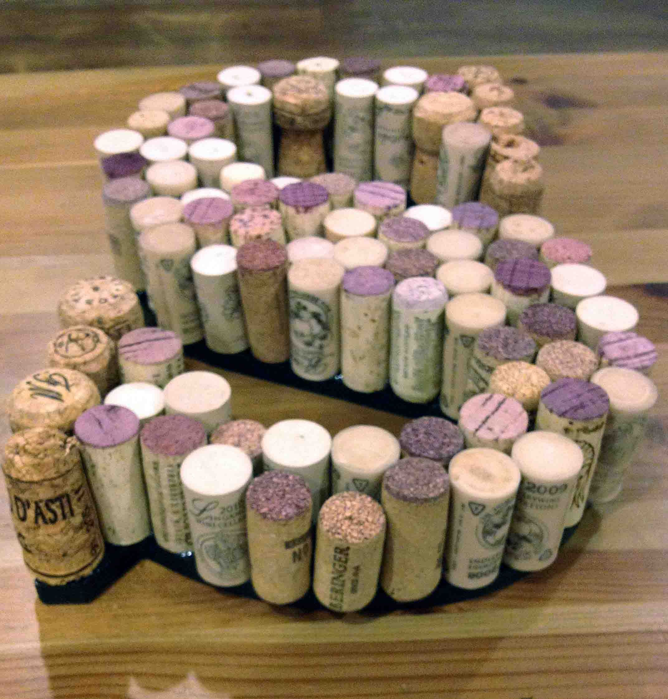 hot glue corks to a large scale wooden letter, try \