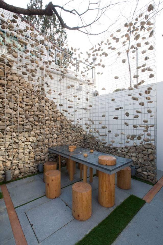 decorative gabions stones rock walls decocative lights stone gabion cafe ato by design bono seoul store design - Gartenideen Wall