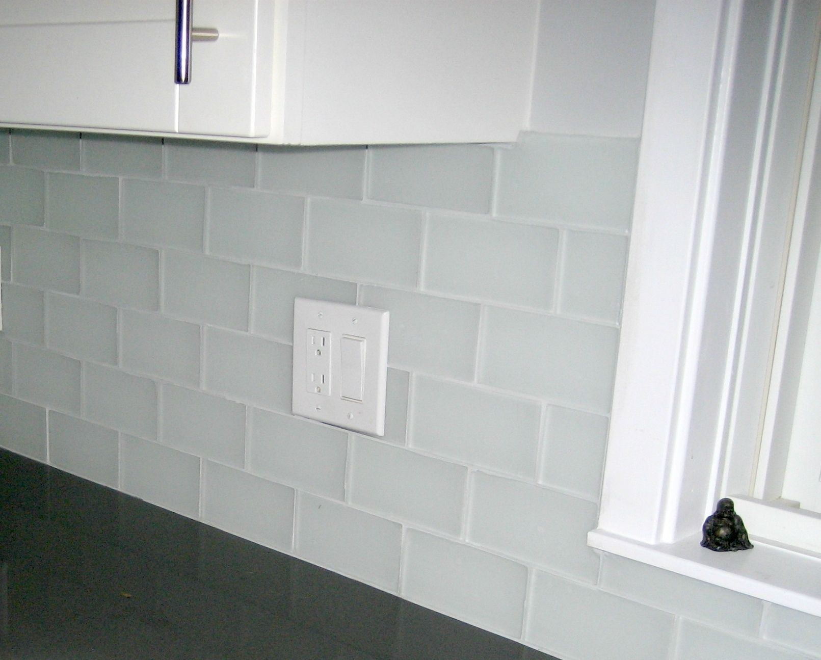 clear glass mosaic tile backsplash