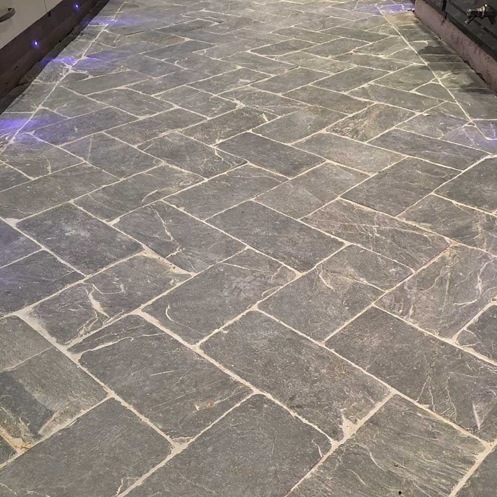 Slate herringbone grey tiles herringbone tile herringbone pattern our hardwearing slate herringbone tiles can be used inside and outside to create a traditional dailygadgetfo Choice Image