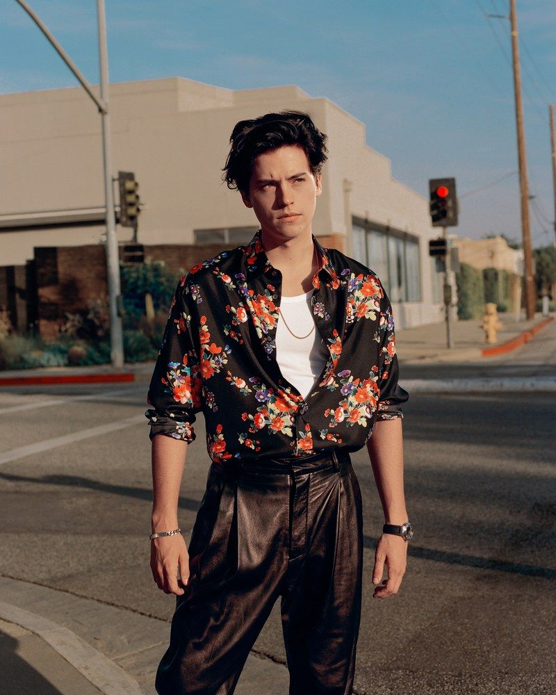 cole sprouse stands at an intersection  Shirt, $1,100, by Dior Men / Tank top, $149, by Boss / Pants, $1,790, by Dsquared / Watch, $18,500, by Breguet / Necklace, $215, by David Yurman / Bracelet, $160, by A.P.C.