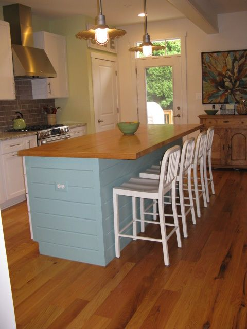 Hank installed ship lap siding around our kitchen island and then primed and painted it this fun color for a beachy feeling.