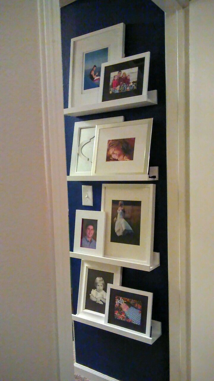 You don't have to have a large wall to showcase your photos. Paint a small wall, add shelves and create your own gallery.