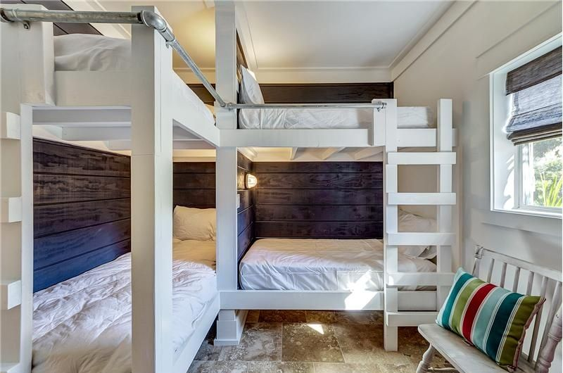 Custom Bunk Beds rustic guest bedroom with crown molding, custom bunk beds