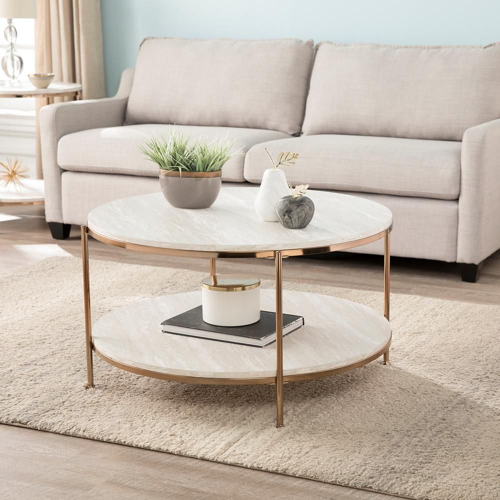 Southern Enterprises Kaitlyn 34 In Gold Medium Round Resin Coffee Table With Shelf Hd698465 The Home Depot Coffee Table Stone Coffee Table Coffee Table With Storage [ 1000 x 1000 Pixel ]