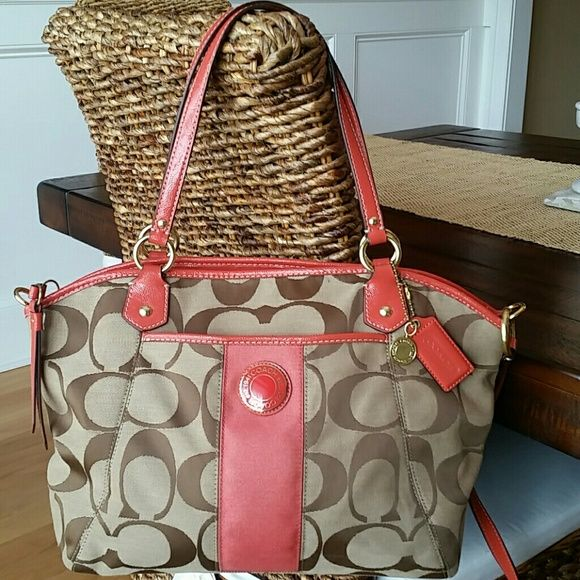 "REDUCED! Coach Signature Stripe handbag Perfect to wear this Spring and Summer!! 100% authentic like new Coach signature stripe pocket handbag. Color is persimmon. Handles with 8"" drop. Convertable detachable strap for cross body wear. Zip top closure. Inside cell phone and multifunction pockets with zipper pocket.. 12 1/2"" (L) x 11"" (H) x 5"" (W). Matching wallet available. See my closet for that listing. :) Coach Bags"