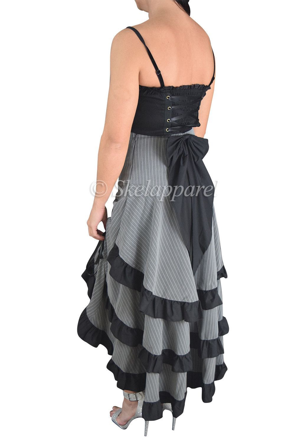 eac76b7e68 This gorgeous high waist-banded skirt features an High-Low style with an  ankle-length tail at the back with three tiers of ruffles