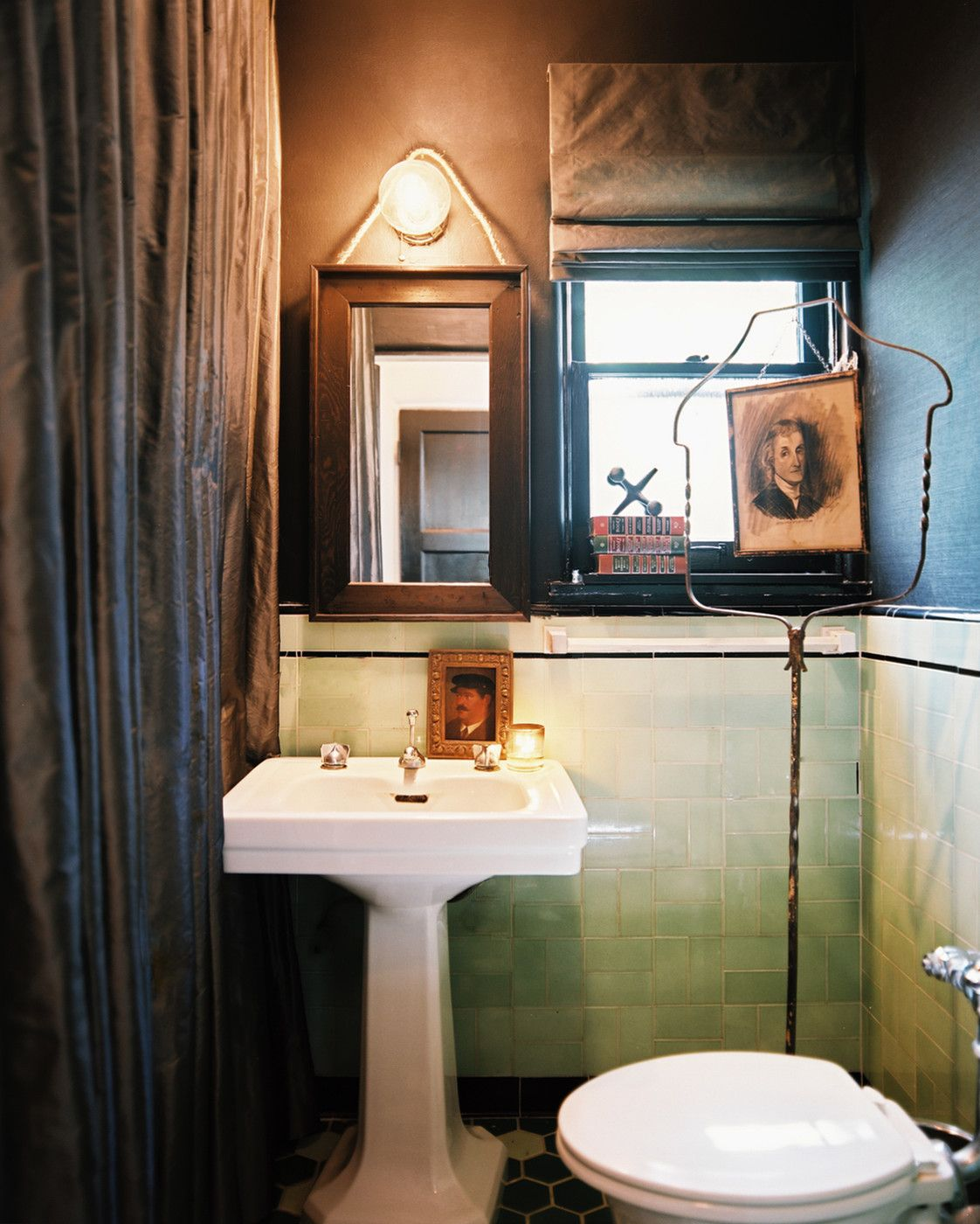 Bohemian Vintage Bathroom: Vintage green tile and a white pedestal sink contrasted with black accents.