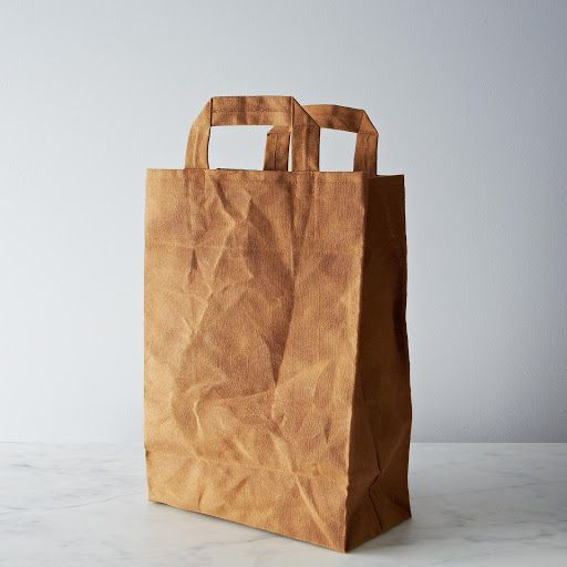 "Love This! Waxed Canvas Market Bag  Provisions by Food52 Made of: 100% cotton canvas, organic beeswax Size: 12.5"" x 18"" x 6"" when fully open, excluding handles $60 (ouch!) Sourced from: Italic Home"