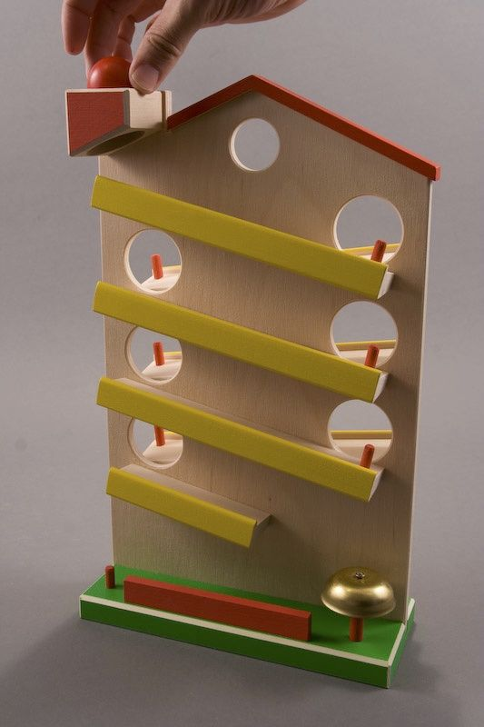 The Ringing Bell Tower is One of The Most Brightly Colored Toys with a Ringing Bell Waiting at the Bottom to be Rung by the Three Balls Running Towards the Bottom.