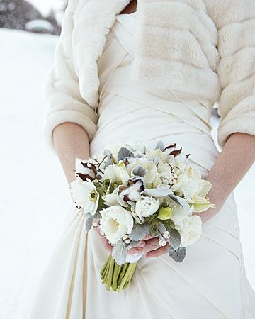 A winter-white bouquet of ivory ranunculus, parrot tulips, and anemones