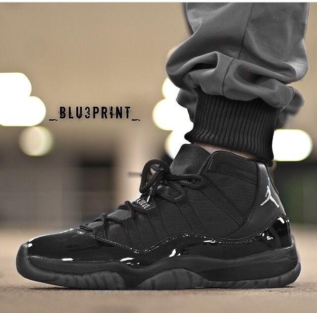 air jordan 11 blackout tags sneakers hi tops all black shiny on feet gray joggers