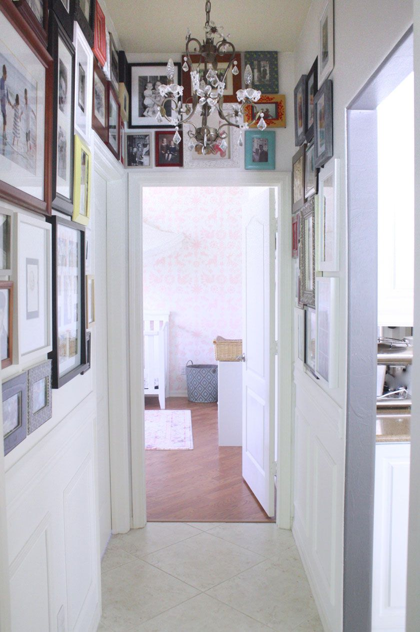 Hallway gallery with mismatched frames | Photo gallery hallway ...